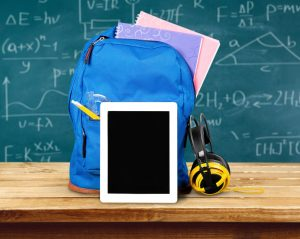 Ipad. Apple iPad on White with a School Backpack